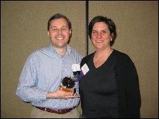 Jay Hale receiving the 2006 Member of the Year Award from last year's recipient Dawn Klug